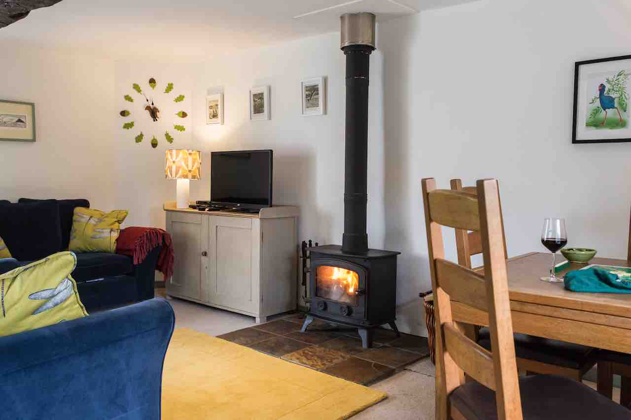 Snuggle up in front of Butterdon's cosy woodburner after a long walk on the moor.