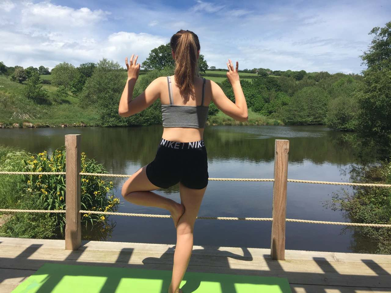 Yoga on the platform overlooking Bridesmere Lake
